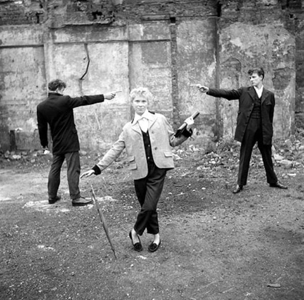 A Question of Honour - Last of the Teddy Girls 16 year old Eileen from Bethnal Green, with two Teddy Boys dueling over her on an East End bombsite, London 1955