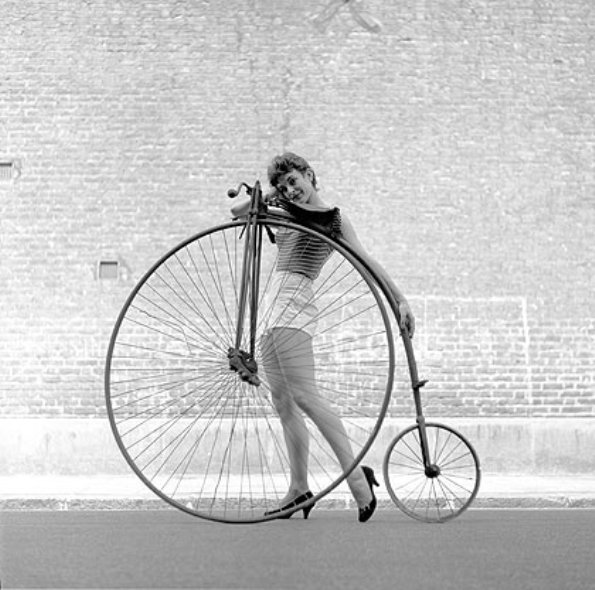 Beauty and the Bike - 24 year old Frances Pidgeon with a Penny Farthing bicycle borrowed from the Troubadour Coffee House - first in the great revival of coffee bars, London 1956