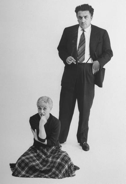 Italian dir. Federico Fellini and actress wife Giulietta Masina posing in studio
