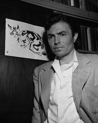 Actor James Mason beside an illustration of cat he has drawn