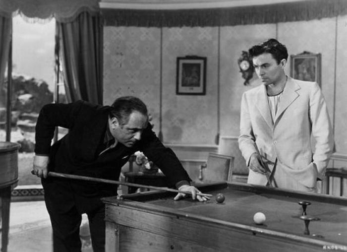 Frederick Valk and James Mason in a scene from Hotel Reserve